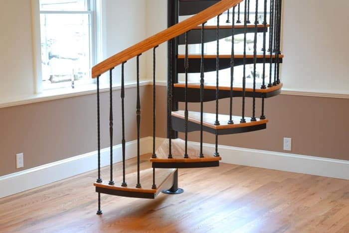 residential steel spiral stair with wood accents