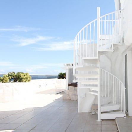 all white spiral staircase miami deck