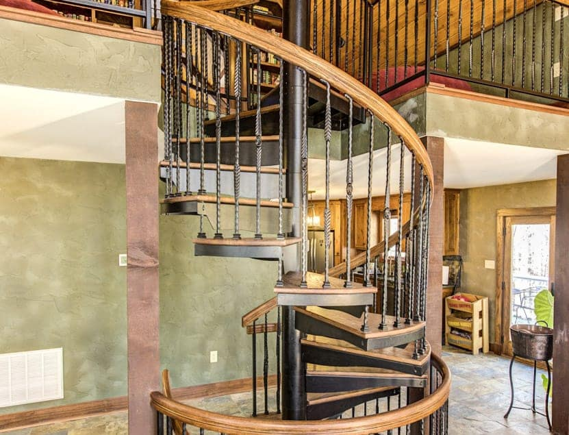 multi level living room spiral staircase
