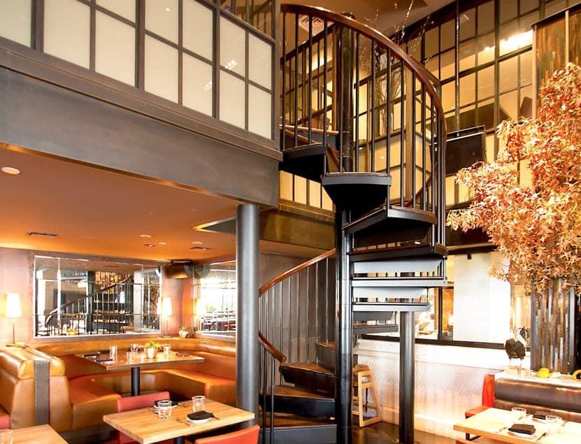 manhattan restaurant dining room with spiral stair