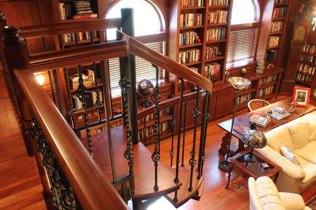 forged iron spiral stair with cherry accents