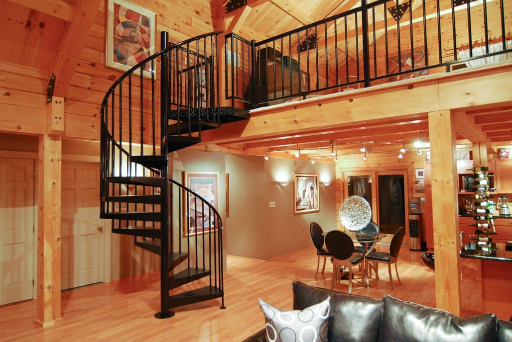 steel spiral stair in all wood cabin