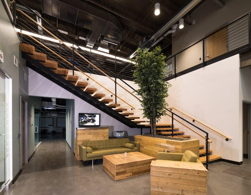 modern office lobby with floating staircase